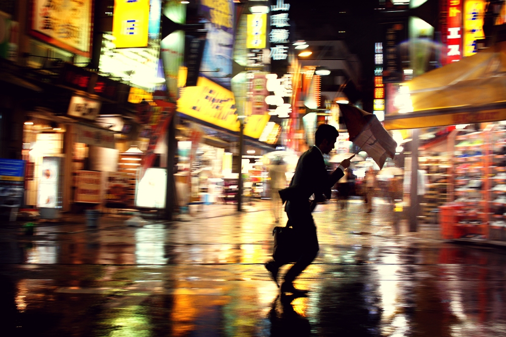 Man crossing the streets in Tokyo